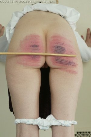 Real Spankings - Holly's Severe Caning - image 15