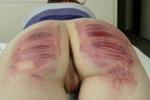 Real Spankings - Holly Is Interviewed And Caned - image 9