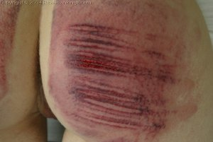 Real Spankings - Holly Is Interviewed And Caned - image 4