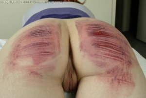 Real Spankings - Holly Is Interviewed And Caned - image 8