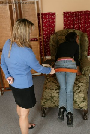 Real Spankings - Janelle Is Strapped At Home - image 7
