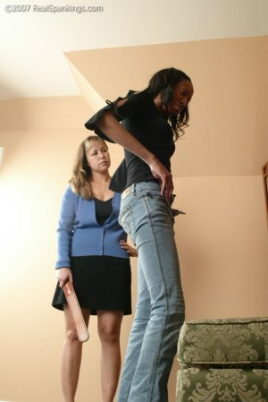 Real Spankings - Janelle Is Strapped At Home - image 2