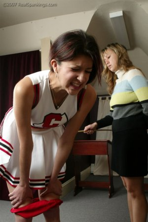 Real Spankings - Brandi's Cheerleading Caning - image 5
