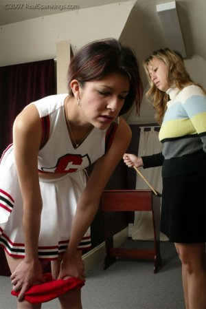 Real Spankings - Brandi's Cheerleading Caning - image 16