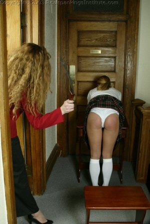 Real Spankings Institute - Jennifer Is Strapped In The Hallway - image 1