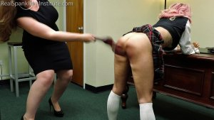 Real Spankings Institute - Kiki's Dress Code Strapping (part 1) - image 6