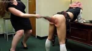 Real Spankings Institute - Kiki's Dress Code Strapping (part 1) - image 13