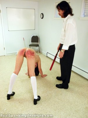 Real Spankings Institute - Melody Caned And Strapped By The Dean (part 1 Of 2) - image 18