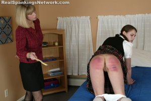 Real Spankings Institute - Melody Gets The Cane - image 7